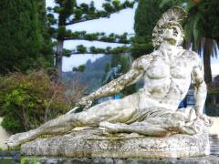17_Statue-of-Achilles-dying,-shot-in-the-foot-with-an-arrow.-Located-in-the-gardens-of-the-Achillion-Palace,-Corfu,-Greece.