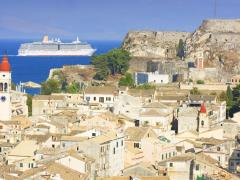 23_Old-city-of-Corfu-in-Greece-with-cruiser-boat-passing